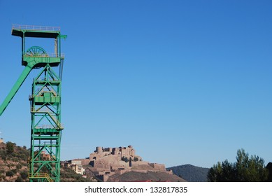 Disused tower mine and Castle of Cardona over a blue sky, Catalonia, Spain