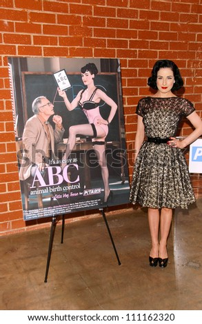 491b1fb4870 Dita Von Teese at a press conference announcing her advertisement for  PETA s Animal Birth Control Campaign. PETA