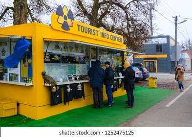 DITYATKI, UKRAINE - NOVEMBER 11, 2018: Unidentified people are near tourist information center and souvenir shop in front of checkpoint Dityatki in Chernobyl NPP alienation zone, Ukraine