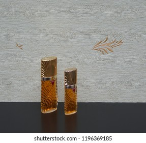 Diva big perfume bottle next to a commercial perfume bottle in front of the satin wallcovering Elysee Kassel, Deutschland, September 15, 2018 : The perfume Diva is distributed by Emanuel Ungaro