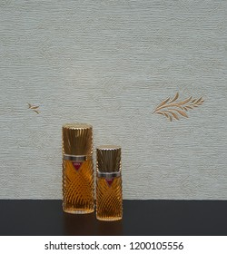 Diva fragrance for ladies big perfume bottle next to a commercial perfume bottle in front of the satin wallcovering Kassel Deutschland 09.15, 2018 The perfume Diva is distributed by Emanuel Ungaro