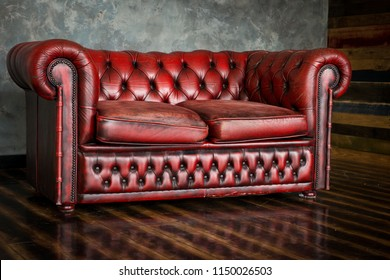The divan is an honor of burgundy color in the interior.