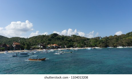 Dive boats and fishing boats lining the shores of Padang Bai, Bali. Gateway to the Gili islands and Lombok.