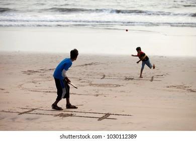 Diveagar, Maharashtra, India, March 2013, Boys playing cricket on beach