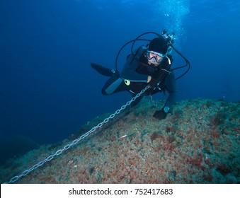 Diver in blue sea.