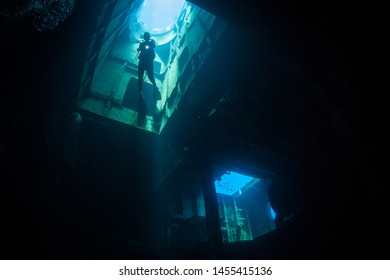 A diver explores the 1, one of the best-known wreck dives in the Caribbean Sea. The 251-foot long ship was sunk off the coast of Grand Cayman in 2011 in order to create an artificial reef.