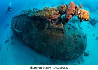 Diver explores small wreck on the Front Porch dive site, Bonaire, Netherlands Antilles