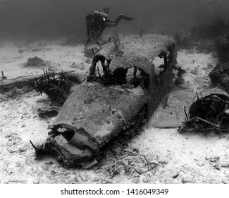 A Diver Explores a Sunken Plane off the Coast of Eleuthera in the Bahamas