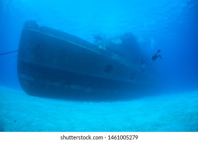 A diver explores the USS Kittiwake, one of the best-known wreck dives in the Caribbean Sea. The 251-foot long ship was sunk off the coast of Grand Cayman in 2011 in order to create an artificial reef.