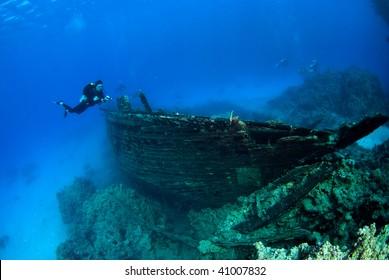 Diver exploring a ship wreck