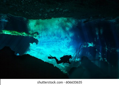 Diver exploring underwater world of Azul cenote