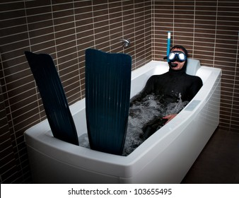 diver with flipper in a bathtub