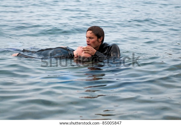 Diver giving CPR to a diving casualty
