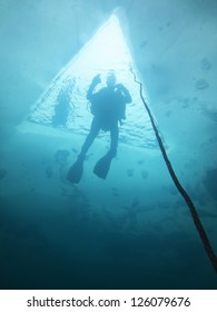 Diver goes to the surface at ice diving