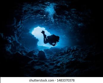 diver hovering inside a cave