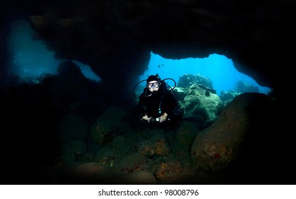Diver in Lava Tube in Kona Hawaii close up