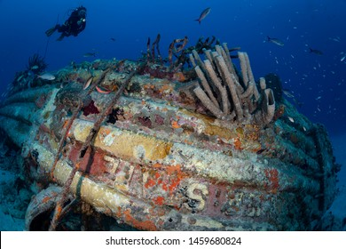 Diver on small wreck on the Front Porch dive site, Bonaire, Netherlands Antilles