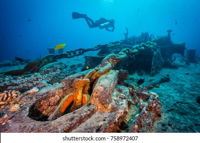 Diver over the anchor chain of Thistlegorm wreck. Northern Red Sea.