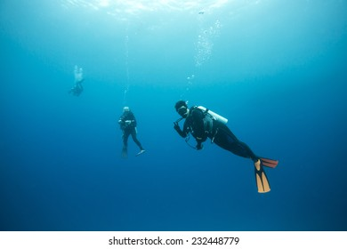 Diver stop at about 5 meters underwater to decompression before finish dive.