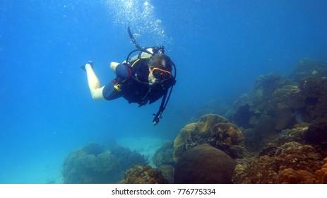 Diver underwater. Diving. Water sports. Thailand underwater. High resolution
