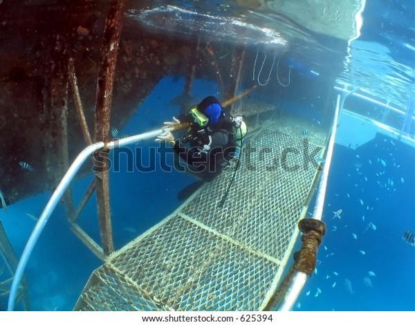 Diver Working On Underwater Platform Some Stock Photo (Edit