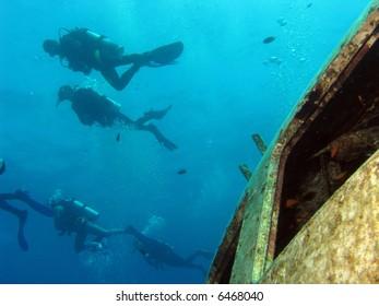 Divers above a shipwreck
