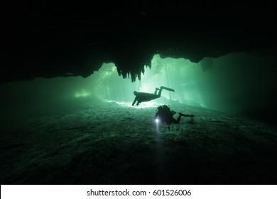 Divers in the cenote Dreams Gate, at Playa del Carmen, Riviera Maya, Mexico