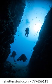 Divers in a deep Canyon
