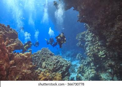 Divers explore cave's