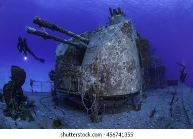 Divers exploring the aft section of the Tibbetts wreck in Cayman Brac