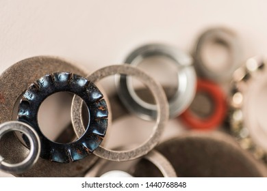 Divers industrial washers and rings. Various colorful washers rings on white background Screw washer
