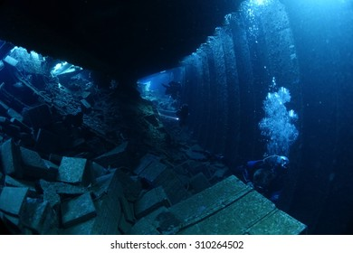 Divers inside the shipwreck of the Chrisoula K - natural light