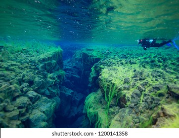 Divers in Silfra Crack, Thingvellir National Park, Iceland,