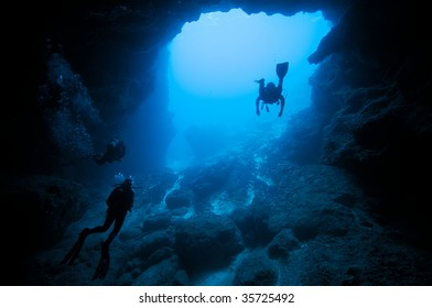 divers in underwater cave