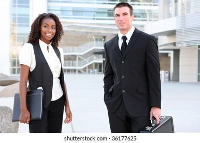 A diverse african and caucasian man and woman business team