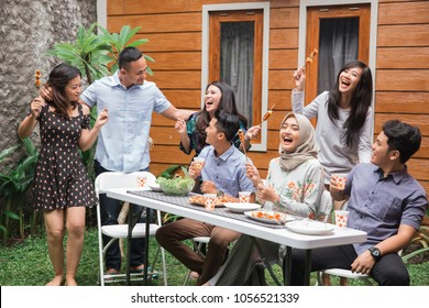 Diverse asian people friends hanging together party concept in the backyard
