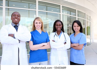 A diverse attractive man and woman medical team at hospital building