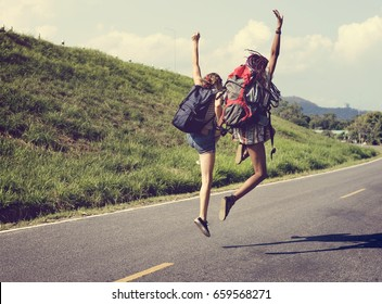 Diverse Backpacker Women Jumping The Street