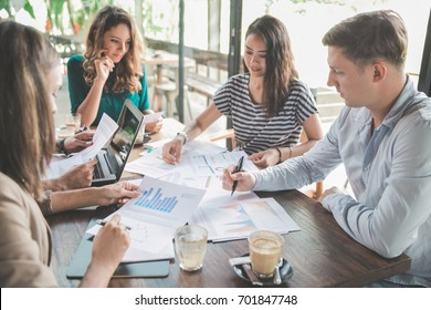 diverse business team meeting in a coffee shop