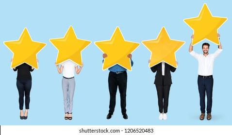 Diverse businesspeople showing golden star rating symbol
