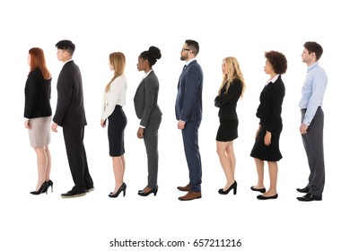 Diverse Businesspeople Standing In Row Over White Background
