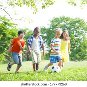 Diverse Children Playing Ball in The Park