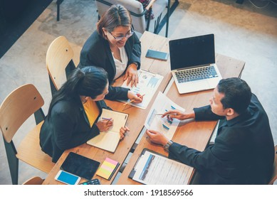 Diverse company collaboration meeting brainstorming business workplace. Asian Company Meeting brainstorming with Collaborate teamwork. Diversity Business people Working Together in company workplace.