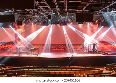 Diverse concert lights on stage with musical instruments