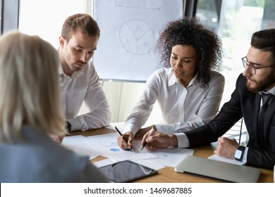 Diverse employees discussing strategy, colleagues sharing startup ideas, business team working on project together, reading documents, analyzing statistics, group negotiations in boardroom