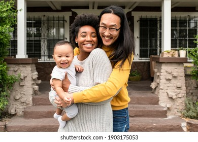 Diverse family standing in front of the house during covid19 lockdown