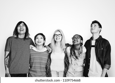 Diverse friends arms around and smiling