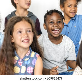 Diverse group of children sitting on the floor