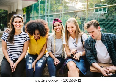 Diverse group of friends hanging out in the park millennials and youth culture concept