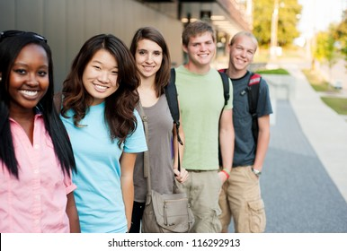 Diverse group of friends in a line smiling